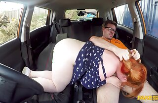 A fat redhead chick rides a stiff unearth during a driving lesson