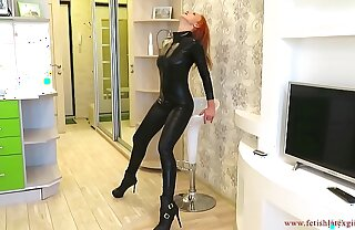 Busty woman in a suit of electrical tape and catsuit spanks herself in a tight ass