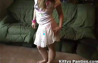 Teeny teen Kitty flashing her panties in a tiny miniskirt